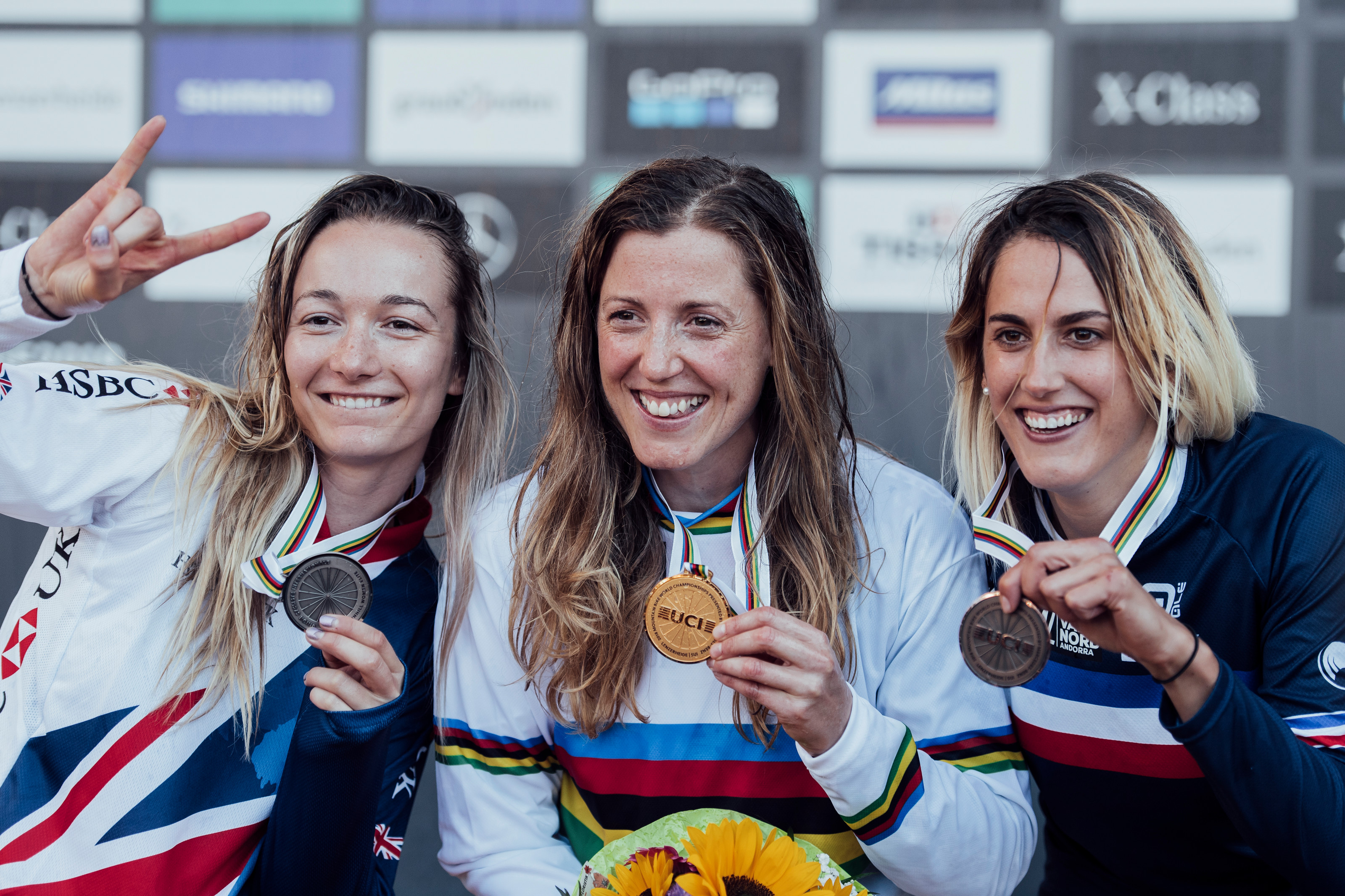 1e8a698a145 Tahnee Seagrave, Rachel Atherton, Myriam Nicole pose with the medals at the  UCI DH World Championships in Lenzerheide on September 9th, 2018.