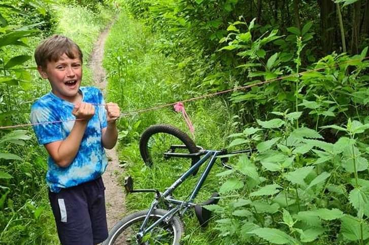 Forest ride turns terrible for Kent family as rope trap catches son