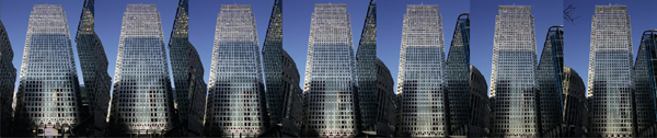 Convergence Shot - This series of images shows how distance affects converging verticals. For each image, I moved 15 paces back from my previous position and zoomed in so that the building was filling the same proportion of the frame each time. As the image was taken from greater and greater distances, the effect of converging verticals became less apparent.