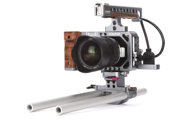 A cage provides a nice grip for handholding a camera, as well as sockets and rails for mounting accessories