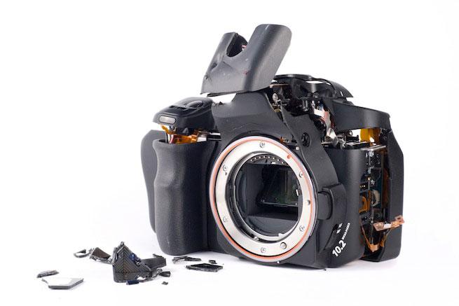 how to fix a jammed digital camera lens