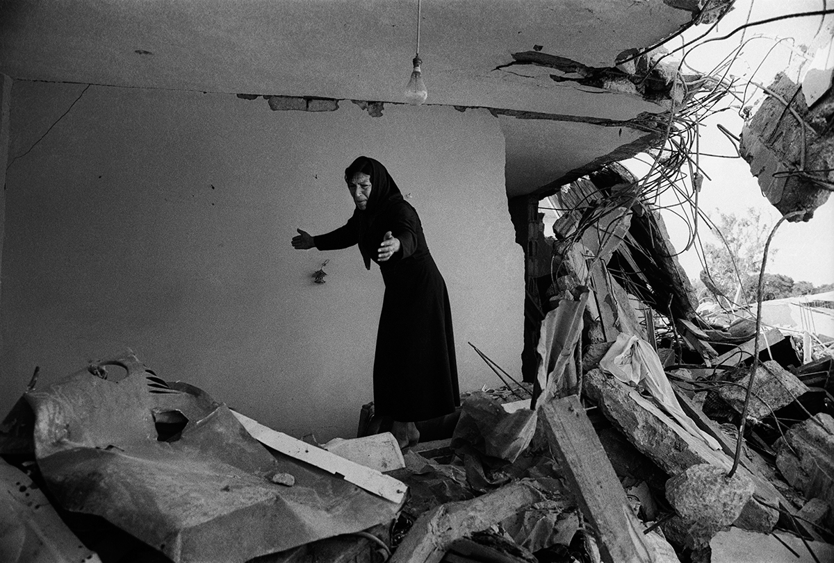 A palestinian woman returning to the ruins of her house sabra beirut 1982