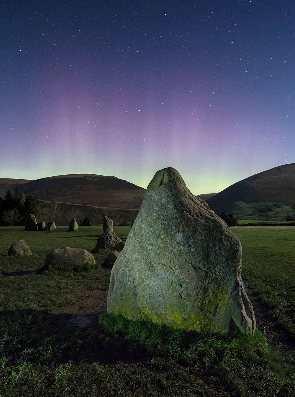 low-light Aurora over Castlerigg Stone Circle