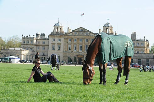 Groom Laurie Robinson relaxing in front of Badminton house with Twinkle Bee