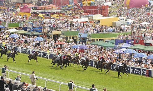 A race at the Investec Derby Meeting