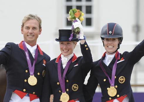 British dressage team on the podium receiving thier medals