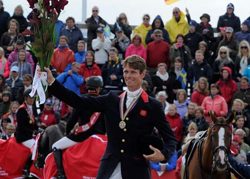 William Fox-Pitt collects his bronze medal from the European Eventing Championships