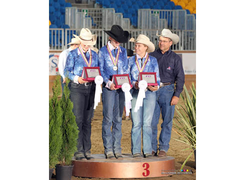 Bronze medal team Isobel Le Pla, Fiona Howard, Tabitha Sternberg Allen and Doug Allen (Chef d'Equipe) on the podium