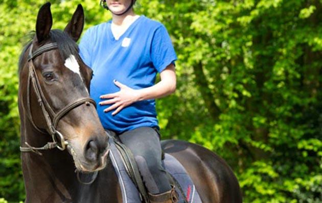 pregnant lady riding a horse