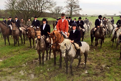 Jockeys out hunting on ponies on Boxing Day
