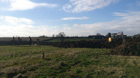 Quorn hunt next to a digger at Lauren Shannon's new yard