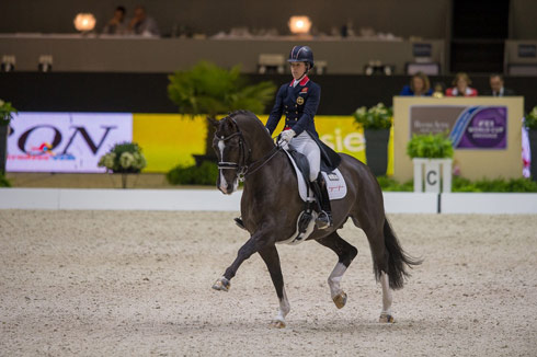 Charlotte Dujardin and Valegro win the grand prix at the Reem Acra FEI World Cup Dressage Final 2014