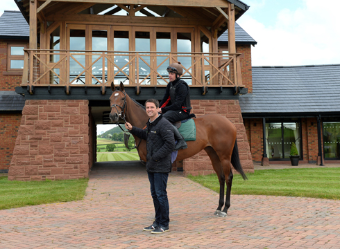 Michael Owen with Destiny's Kitten out side Manor House Stables