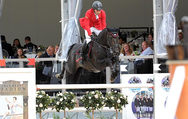 Hans-Dieter Dreher (DE) riding Embassy II DSQ th in the Grand Prix Presented by Qatar at the Longines Global Champions Tour of London taking place on Horse Guards Parade in central London between the 14-16th August 2014