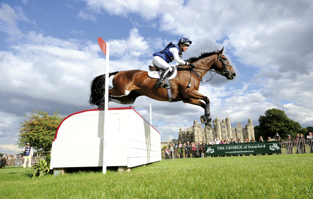 Kristina Cook  riding DE NOVO NEWS  during the cross country phase of The Land Rover Burghley Horse Trials, Stamford UK, September, 2013