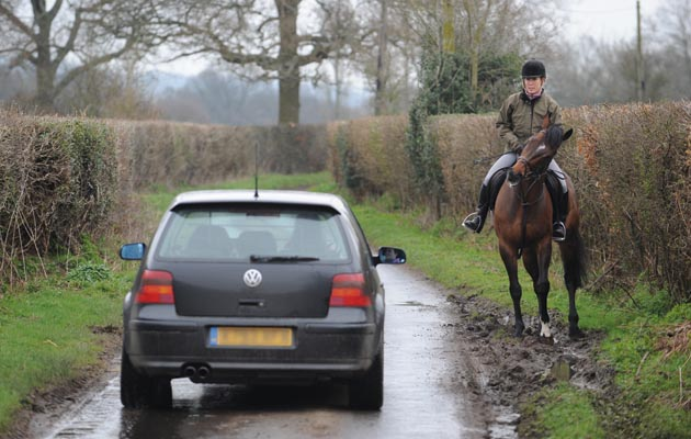 Hacking Out Horse&Hound. Hacking out. Ockley, Surrey, UK. Photo: Steve Bardens, car passing rider in country lane