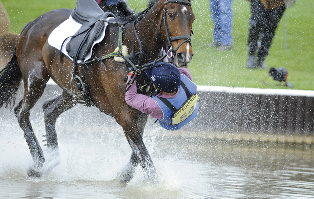 James Robinson and Comanche take a rather wet fall . Comanche has other ideas about continuing the trial !