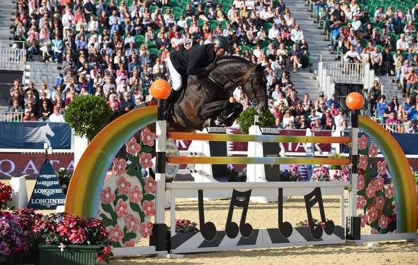 John Whitaker riding Argento 2nd in the Longines Global Champions Tour Grand Prix of London (Class 10 CSI5*) presented by Qatar, Jumping Competition at the Longines Global Champions Tour of London 2015 at Syon Park in London, UK on 25 July 2015