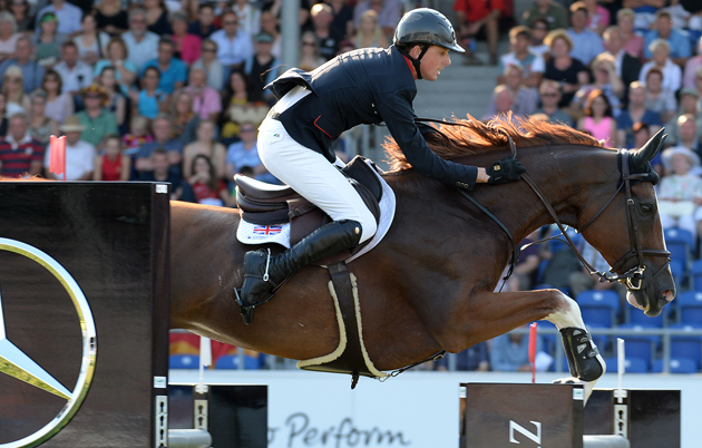 Ben Maher and Diva II on the third day of the European Showjumping Championships 2015. Picture by Peter Nixon