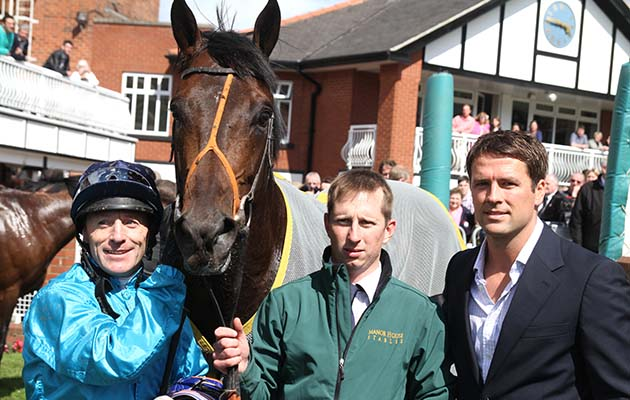 Kieren Fallon, owner-breeder Michael Owen and groom Christopher Ely with Brown Panther after winning the totepool Pontefract Castle Stakes Pontefract 24/6/2012 photo:Alec Russell/racingfotos.com THIS IMAGE IS SOURCED FROM AND MUST BE BYLINED