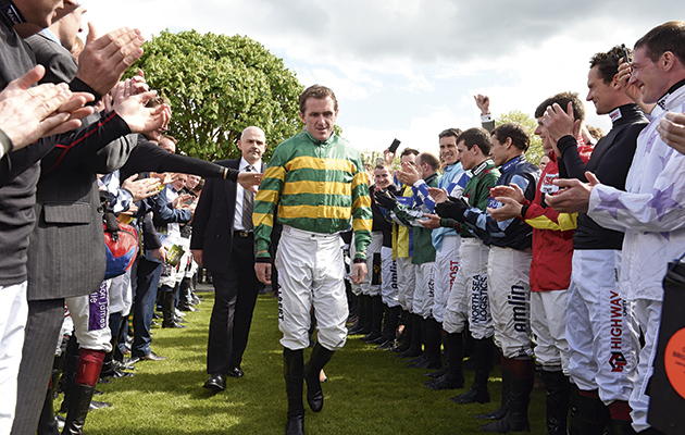 AP McCoy is applauded into the Parade ring by his fellow jockeys, followed by his loyal agent, Dave Robertds  25-4-15