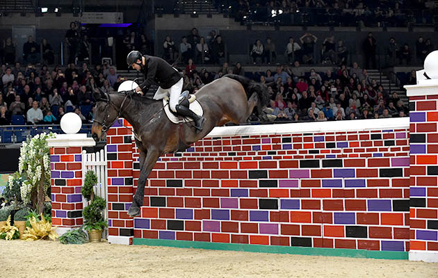 PETER SMYTH riding CAVALIER RUSTICANA during Puissance Show Jumping Class (Class 04), at The Equestrian.com Liverpool International Horse Show 2016 at Olympia, London, UK on 1st January 2016 liverpool international horse show discount codes