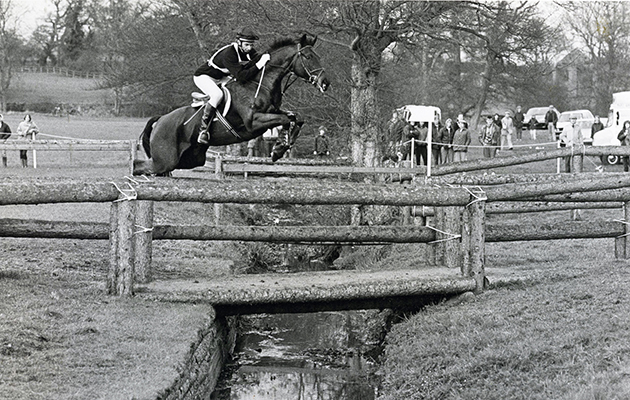 Charisma with Mark Todd over the footbridge at Badminton