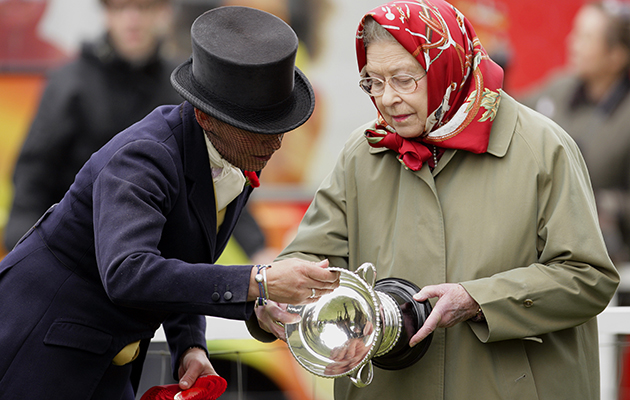 WINDSOR, UNITED KINGDOM - MAY 14: (EMBARGOED FOR PUBLICATION IN UK NEWSPAPERS UNTIL 48 HOURS AFTER CREATE DATE AND TIME) Katie Jerram and Queen Elizabeth II inspect the trophy that Queen Elizabeth was presented after Katie won the 'Ladies Side Saddle' class on Queen Elizabeth's horse 'Stardust III' during day 3 of the Royal Windsor Horse Show on May 14, 2010 in Windsor, England. (Photo by Indigo/Getty Images) *** Local Caption *** Katie Jerram;Queen Elizabeth II
