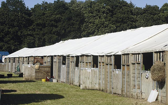 event stables , wooden stables with canvas roofs , temporary stabling ,