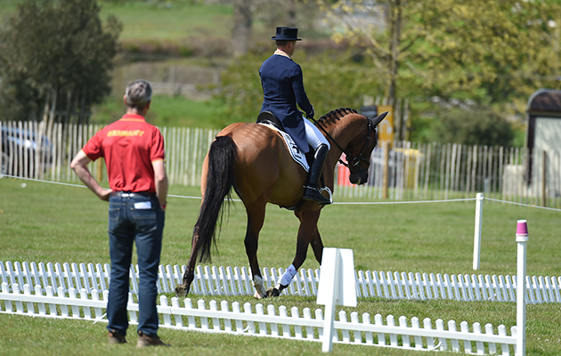 Michael Jung riding La Biosthetique - Sam FBW GER - warming up for dressage with Chris Bartle - during the Dressage Phase of The Mitsubishi Motors Badminton Horse Trials at Badminton in Gloucestershire, UK on 5th May 2016