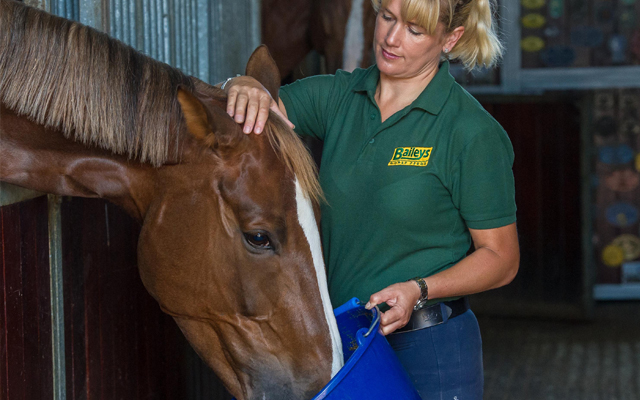 laura-with-bucket-and-horse-crop