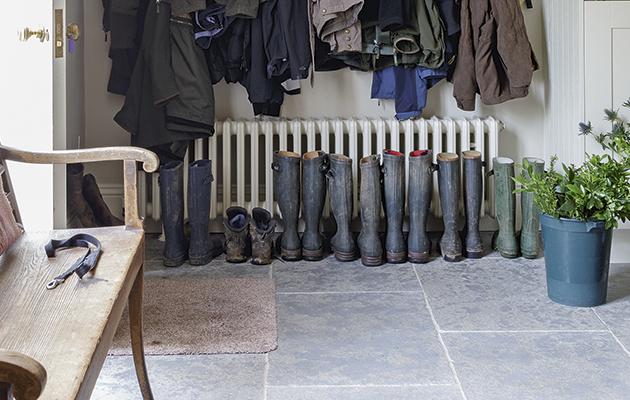 Pub orig. Boot room, slate flooring, coat hooks and coats, bench, wall clock