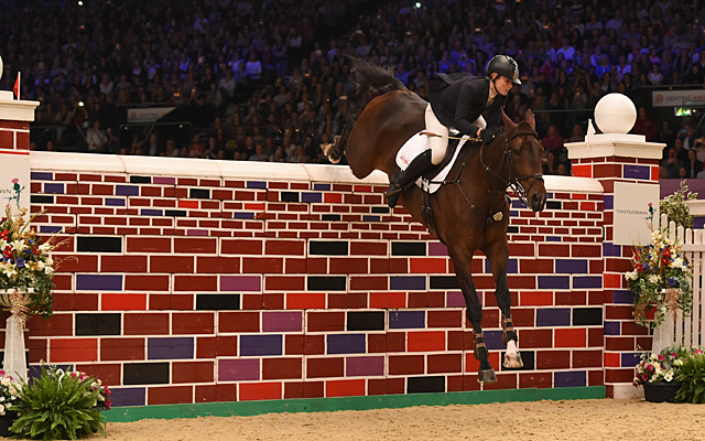 Holly Smith riding QUALITY OLD JOKER, winner of The Thistledown Puissance during HOYS in the NEC in Warwickshire in the UK on 8th October 2016