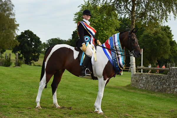 MISS LUCINDA FARMBROUGH   riding TAMBROOK MY DESTINY, winner in The Sophie Donald Equestrian Supreme Skewbald & Piebald Indian Trail Ridden Championship during the Royal International Horse Show at The All England Jumping Course, Hickstead, West Sussex, UK  on 26 July 2016