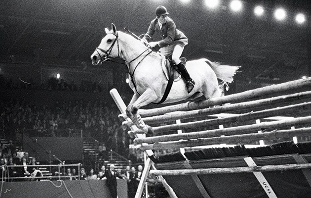 Nick Skelton and Lastic winning the high jump at Olympia in 1978. Setting the record at 2.32m