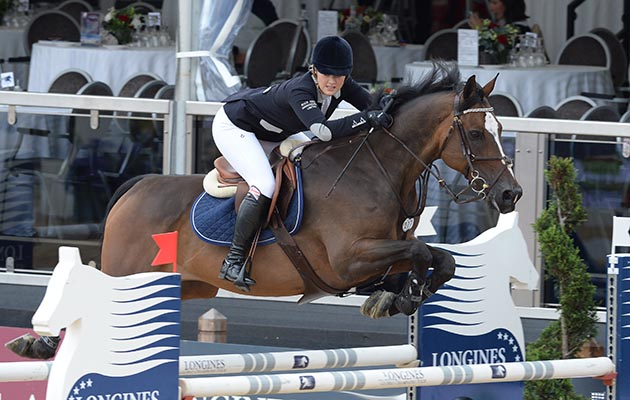 Leonora Smee riding Waltons Top Flight during Grant Road Partners LLC Prix at the Longines Global Champions Tour of London taking place on Horse Guards Parade in central London on 15 August 2014