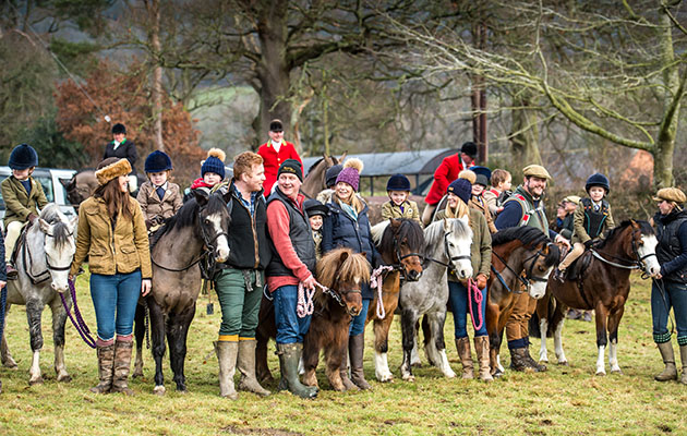 Some of the 14 lead rein children with their parents. children child kids hunt hunting