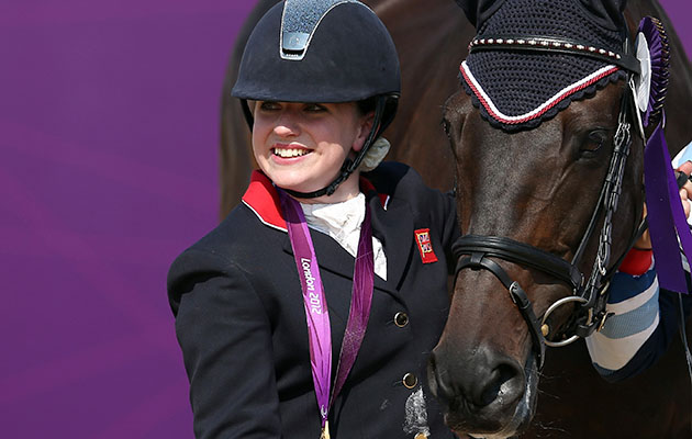 LONDON, ENGLAND - SEPTEMBER 03: Natasha Baker of Great Britain with Cabral wins gold in the Dressage Individual Freestyle Test, Grade II in the Equestrain on day 5 of the London 2012 Paralympic Games at Greenwich Park on September 3, 2012 in London, England. (Photo by Julian Finney/Getty Images)