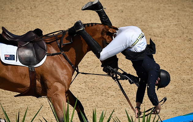 Australia's Scott Keach falls during the 2nd round of the equestrian's jumping individual and team qualifier event of the Rio 2016 Olympic Games at the Olympic Equestrian Centre in Rio de Janeiro on August 16, 2016. / AFP / PHILIPPE LOPEZ (Photo credit should read PHILIPPE LOPEZ/AFP/Getty Images)