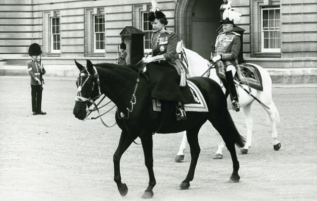 A reflective moment for the queen, riding Birmese, when she left Buckingham Palace for the Trooping the Colour Ceremony at Horse Guards June 11th 1983