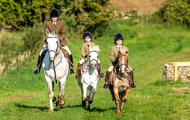 Stars of the future? Sarah, Lizzie and Mary Pope autumn hunting with the Beaufort in September