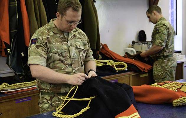 "Corporal of the Horse and Master Tailor Adam Blackmore-Heal makes adjustments to a uniform in preparation for the Royal wedding. The Household Cavalry Mounted Regiment will provide a travelling escort for the newly wed Prince Henry of Wales and his bride Ms Meghan Markle through Windsor on 19th May. The event which will be broadcast live globally, will be a matter of huge pride and professional honour for the soldiers responsible and work is already underway behind the scenes to ensure they deliver a performance to make the nation and their brother officer proud. Prince Harry joined The Blues and Royals in April 2006 and served with the Household Cavalry Regiment, serving operationally in the frontline in Afghanistan and rising to the rank of Captain. Several of those who trained and served with him will be supporting ""Mr Wales"" (as they knew him) on his wedding day whether riding in the escort or as staircase liners on the steps of St George's Chapel where the marriage service will take place. Today the world's media got a glimpse behind the scenes at the regiment's Hyde Park Barracks in Knightsbridge. It helped them to understand the painstaking effort these soldiers go to to prepare their equipment and horses to an impeccable standard for ceremonial duties. Sgt Paul Randall RLC"