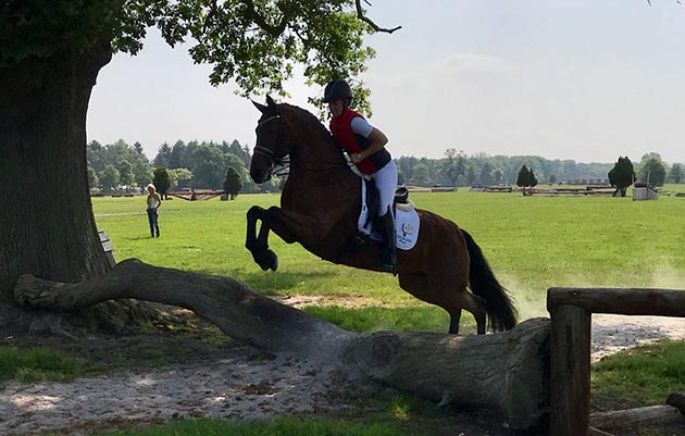 Charlotte Dujardin pops River Rise Escala over a log on the cross-country course at SomerfordPark