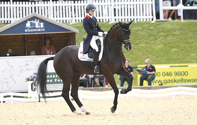 Charlotte Fry riding Dark Legend in the CDI3* Grand Prix during the Equerry Bolesworth International Horse Show at Bolesworth Castle near Chester in Cheshire in the UK on 13th June 2018