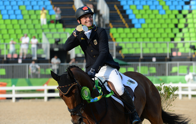 LAP OF HONOUR Michael Jung GER riding La Biosthetique Sam FBW winner of the individual gold medal of the Eventing Competition at the Olympic Equestrian Centre in Deodoro near Rio, Brazil on 9th August 2016