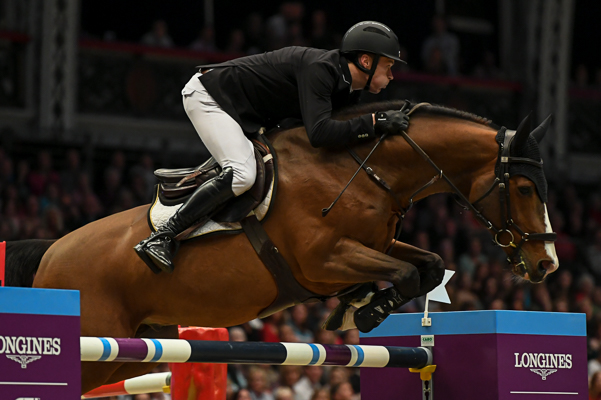 William WHITAKER (GBR) riding Utamaro d Ecaussines in the Longines FEI Jumping World Cup (Class 19) during the Olympia, The London International Horse Show held at Olympia in London in the UK between 17 - 23 December 2018
