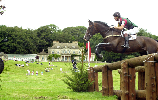 Moon Man, ridden by William Fox-Pitt, jumps the fence with the house in the background at Gatcombe Park, to go on to win the the Doubleprint British Open horse trials Championship.