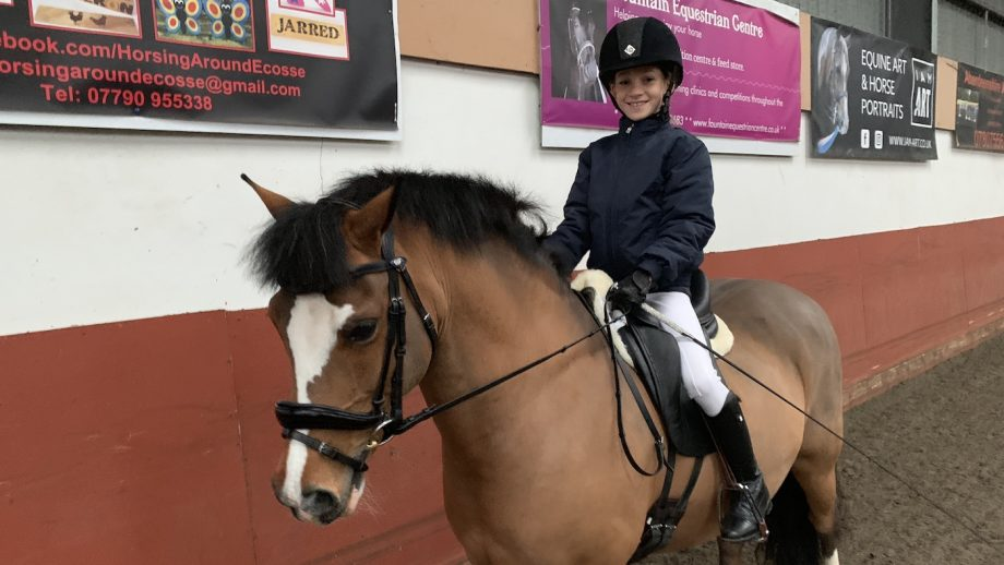 10-year-old dressage fan who rides with a 'smile on her face' scores 93.8%