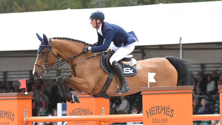 Daniel Deusser riding EQUITA VAN T ZORGVLIET winner of the Bahrain Pearl Stake during the Royal Windsor Horse Show private grounds of Windsor Castle, in Windsor in the county of Berkshire, UK
