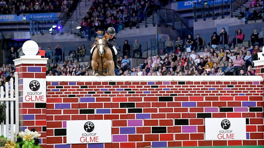 Matthew Sampson riding Top Dollar VI in the CSI4* Puissance - Sponsored by: EQUITOP GLME showjumping class 07, during the TheraPlate UK Liverpool International Horse Show in the UK between 28th - 31st December 2018